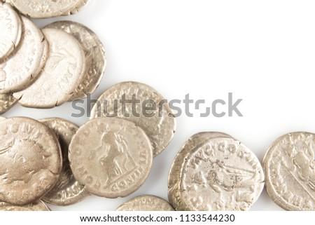 Roman denarius lie on a white background, the era of the Antonin #1133544230