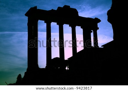 Roman Forum Ruins in Italy.It is photographed against the sun in the evening.