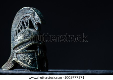 Roman helmet on a dark background