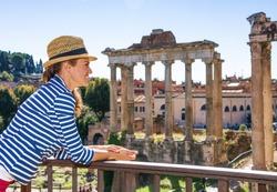 Roman Holiday. happy elegant tourist woman near Roman Forum in Rome, Italy exploring attractions