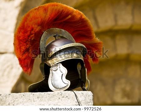 Roman Legionar\'s helmet on the wall with arches in Jerash, Jordan