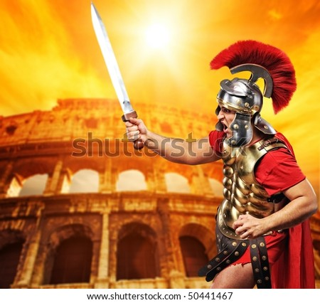 Roman legionary soldier in front of coliseum - stock photo