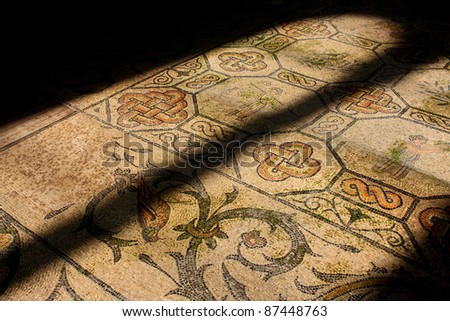 Roman mosaic in old church illuminated by church window