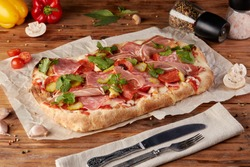 Roman pizza, variant of classic Italian pizza, wooden background