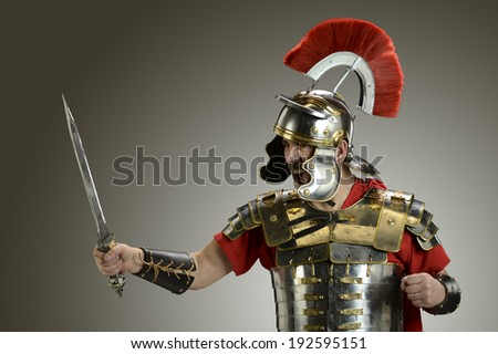 Roman Soldier with sword ready for war - stock photo