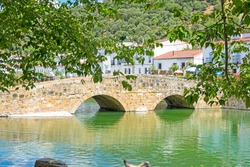 Roman stone bridge over the Galindon river in San Nicolas del Puerto, Seville, Andalusia, Spain
