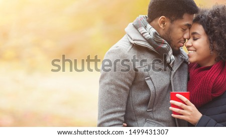 Romance and fall mood. Couple in love with coffee cup, dating in park at autumn #1499431307