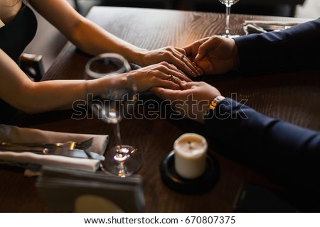 Romance at night restaurant for Valentine's Day. couple holding hands