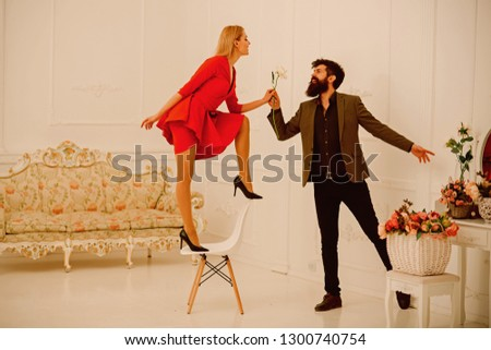 Romance concept. Sensual couple enjoy romance. Bearded man give rose to sexy woman, romance. You are my romance. #1300740754
