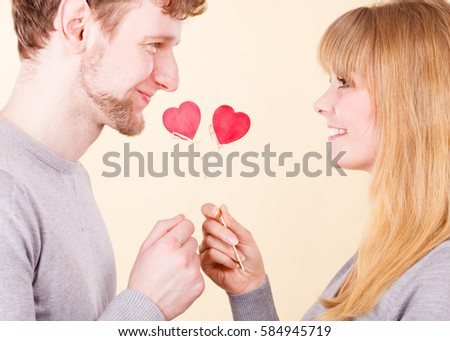 Romance feelings affection relationship concept. Couple in affectionate moment. Enamoured boy and girl exchanging hearts showing love #584945719