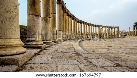 Romand and Ancient Greek typical columns in Rome City of Jerash in Jordan Columns are offset on the lef side of photo