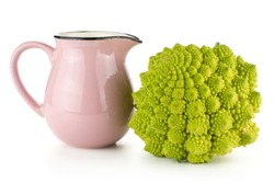 Romanesco cauliflower or broccoli with a pink jar isolated on white background one green head