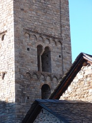 Romanesque bell tower and part of the slate roof of the church in the village of Boí