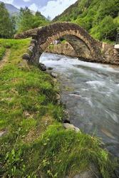 romanesque bridge over a river