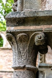 Romanesque capital in medieval abbey. Full frame