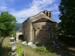 Romanesque Church of Santa Eulalia in the village of Orós Bajo. 11th century. View of the semicircular apse and the cemetery. Serrablo Region. Aragón. Spain.