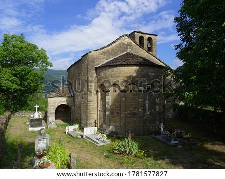 Romanesque Church of Santa Eulalia in the village of Orós Bajo. 11th century. View of the semicircular apse and the cemetery. Serrablo Region. Aragón. Spain.  stock photo