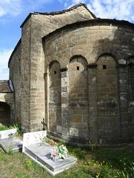 Romanesque Church of Santa Eulalia  in the village of Oros Bajo. 11th century. View of the semicircular apse and the cemetery.  Serrablo Region. Aragon. Spain.
