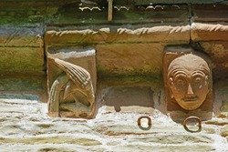 Romanesque sculpture, two stunning carvings on the corbel of The Church of St Mary and St David built in the 12th century, Kilpeck, Herefordshire, England, UK