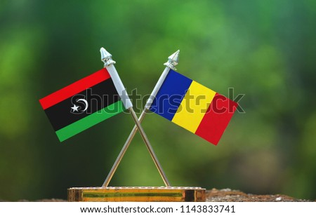 Romania and Libya small flag with blur green background #1143833741