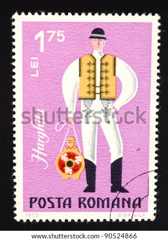 ROMANIA - CIRCA 1973: A stamp (catalogue number Scott 2008 2409) printed in Romania shows image of a Harghita man, from the regional costumes series, circa 1973 - stock photo