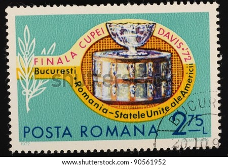 ROMANIA - CIRCA 1972: a stamp from Romania shows image of a tennis racquet and the Davis Cup, circa 1972