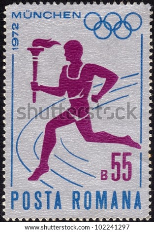 ROMANIA - CIRCA 1972: a stamp printed by Romania shows a runner carrying the torch with the Olympic flame, dedicated to Olympic Games in Munich, circa 1972