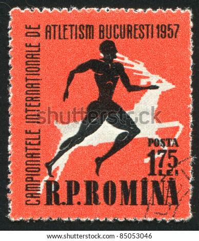 ROMANIA - CIRCA 1957: A stamp printed by Romania, shows Runner, stag, circa 1957
