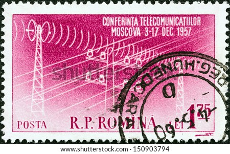 ROMANIA - CIRCA 1957: A stamp printed in Romania issued for the Socialist Countries\' Postal Ministers Conference, Moscow shows Telegraph pole and pylons carrying lines, circa 1957.