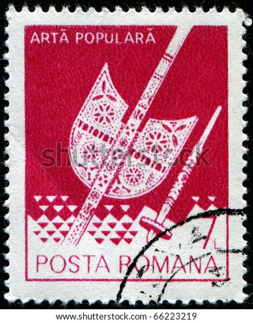 ROMANIA - CIRCA 1982: A stamp printed in Romania shows Distaff and spindle from Transylvania, folk art series, circa 1982