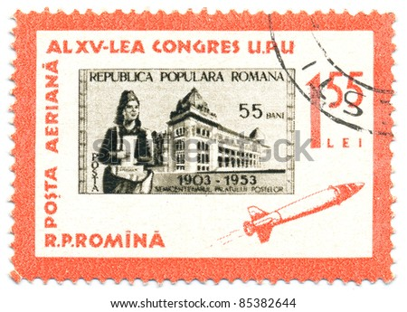 ROMANIA - CIRCA 1963: A stamp printed in Romania, shows Postal Administration build and letter carrier, series Stamps on Stamps, circa 1963