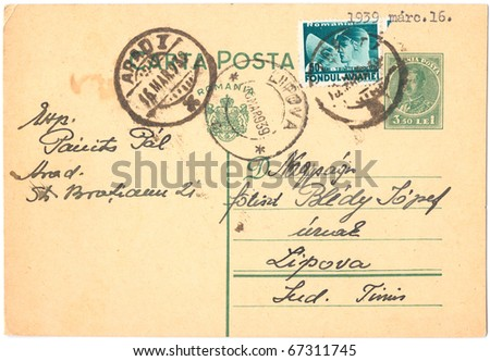 ROMANIA - CIRCA 1939: An old used Romanian postcard and postage stamps from World War II, showing portraits of the King of Romania, was printed in Romania, series, circa 1939 - stock photo