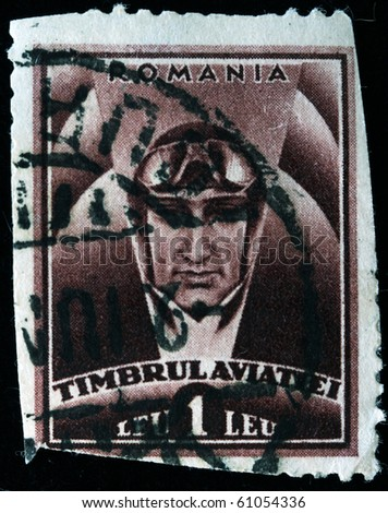 ROMANIA - CIRCA 1950s: A stamp printed in Romania shows pilot with goggles on the helmet, circa 1950s