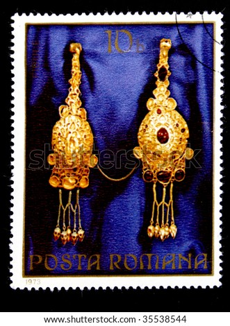 ROMANIA - CIRKLE 1980s: A stamp printed by Romania shows a Golden Suspension bracket with jewels circle 1980s.