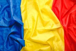 Romania flag background. Romanianational flag as symbol of democracy, patriot. Closeup texture Romanian Flag. Stock photo