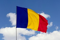 Romania flag isolated on the blue sky with clipping path. close up waving flag of Romania. flag symbols of Romania.