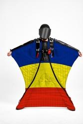 Romania flag travel. Bird Men in wing suit flag. Sky diving men in parashute. Patriotism, men and flag.