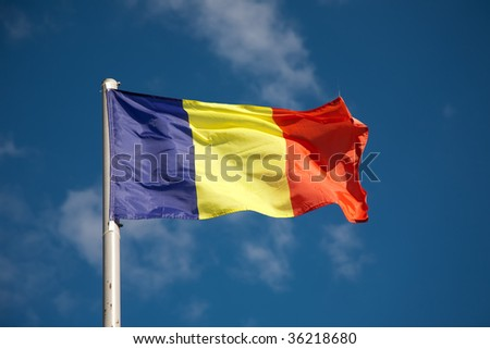 Romanian flag against blue sky