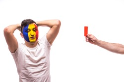 Romanian football fan of Romania national team get red card on grey background. European 2016 football fans concept.