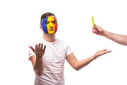Romanian football fan of Romania national team get yellow card on grey background. European 2016 football fans concept.