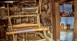 Romanian loom with homemade thread on it, in old clay house