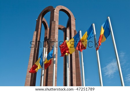 Romanian national flags in front of the unknown soldier mausoleum from Bucharest