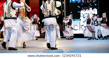 Romanian traditional costumes and dancers on stage. Beautiful designs and authentic.
