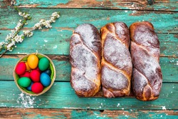 Romanian traditional walnut sweet bread - cozonac with natural dye colored easter eggs