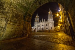 Romanic cathedral of Lugo, view through one of the gates of the two thousand year old Roman wall