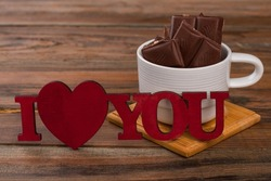 Romantic background with chocolate. I love you.