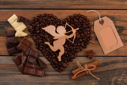 Romantic background with coffee beans and chocolate.