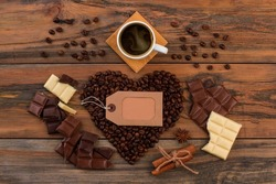 Romantic background with cup of coffee and chocolate.
