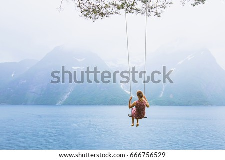 romantic beautiful girl on swing in Norway, happy dreamer, inspiration background #666756529