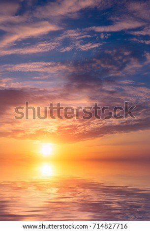 Romantic beautiful sunset in the sky and clouds over the sea. Natural composition #714827716